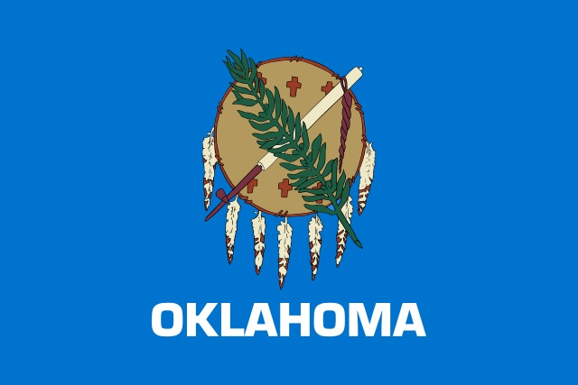 """Flag of Oklahoma"". Licensed under Public Domain via Commons -"